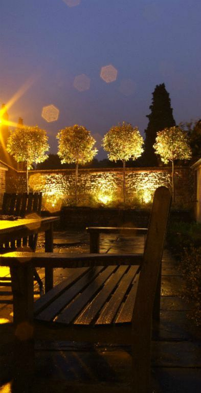 Flint garden wall lighting with bench
