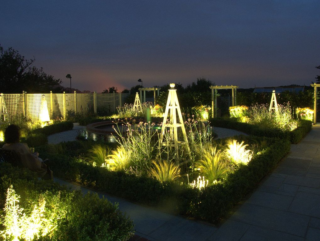 Formal garden lighting with grasses