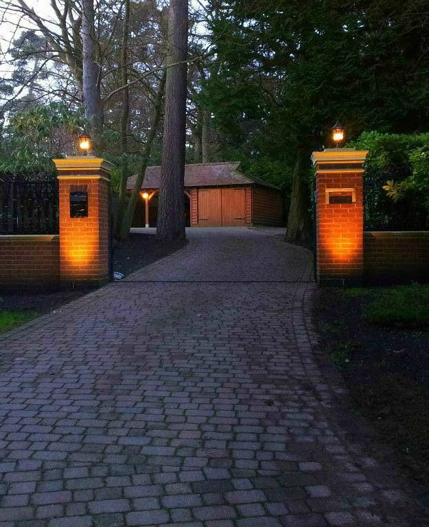 Gatepost lighting with cobbled drive