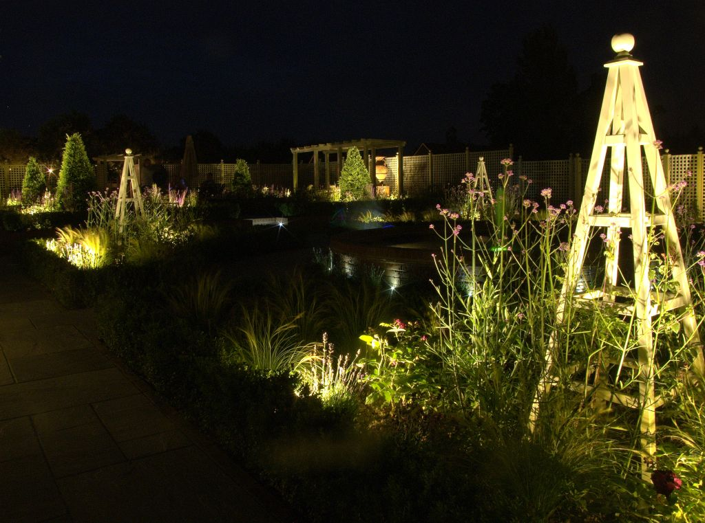 Formal garden lighting with obelisks