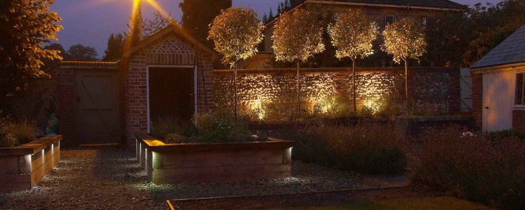 Raised beds and flint wall lighting