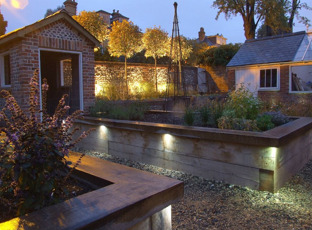 Victorian walled garden lighting with raised beds