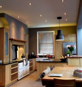 Kitchen interior lighting with downlights and pendant